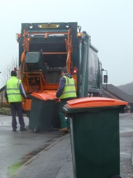 Image of the team collecting garden waste bins