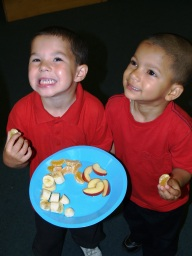Image of two young boys sharing food