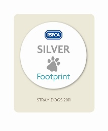 Logo of the RSPCA Silver Stray Dog Footprint award won by Newport council's kennel service in 2011
