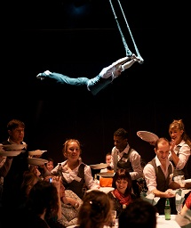 Performers flying high over audience as they eat...